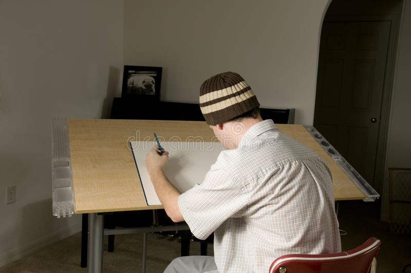 Artist At Drawing Table Royalty Free Stock Photos