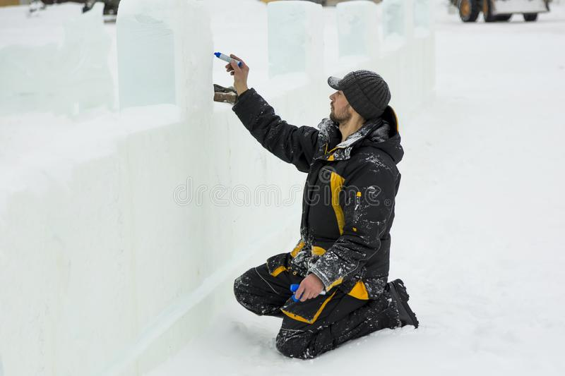 The artist draws on the ice block stock image