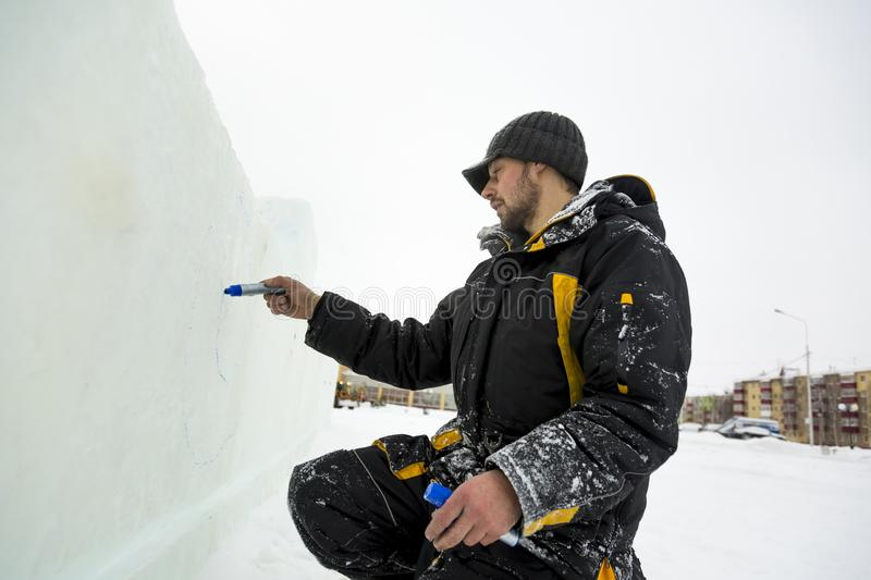 The artist draws on the ice block stock images