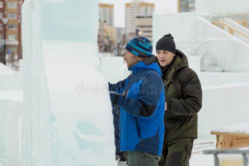 The artist draws on the ice block royalty free stock images