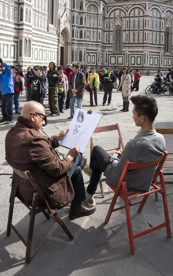 Artist draws a young man. Tourists visiting Giotto's bell tower stock photos