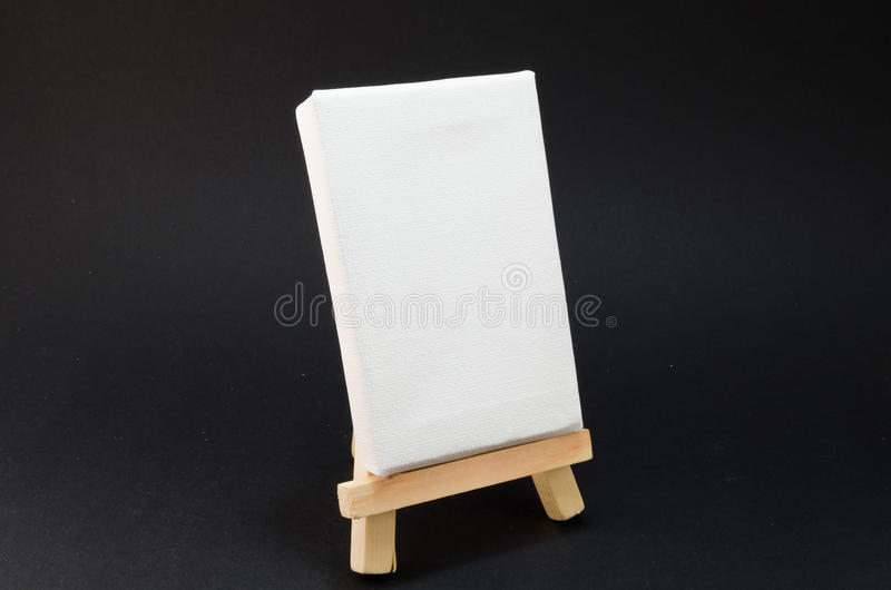 Artist Easel, black background. Miniature artist easel, isolated against a black background stock photography