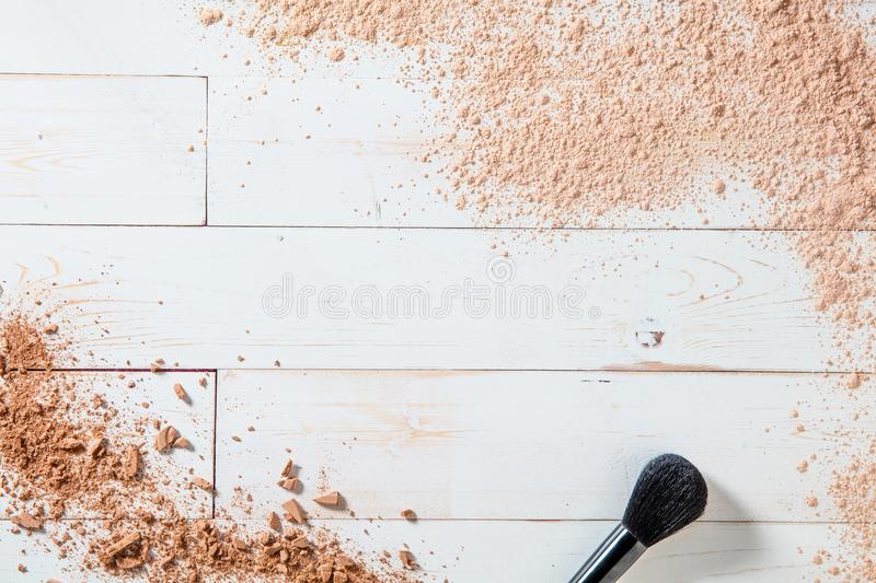 Artist face brush and makeup powder for natural beauty background. Artist face brush for natural beauty and cosmetics background with still life of smashed royalty free stock photo