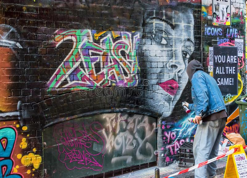 Artist and graffiti in Melbourne, australia royalty free stock photo