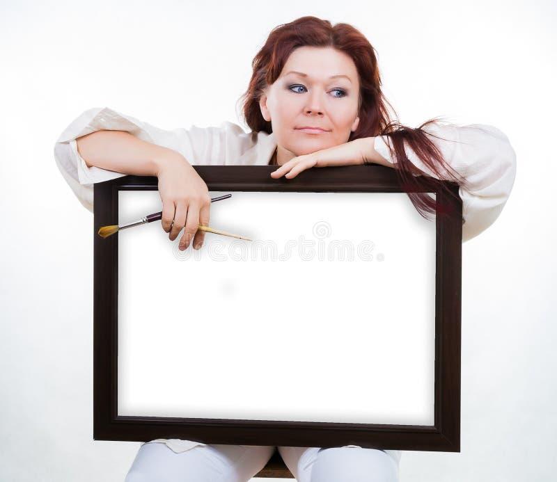 Artist Holds Empty Frame Royalty Free Stock Photo