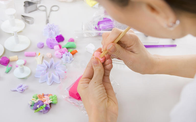Artist makes jewelry from polymer clay, process. Workshop. Artist makes jewelry from polymer clay, artist at work. Workshop royalty free stock photos