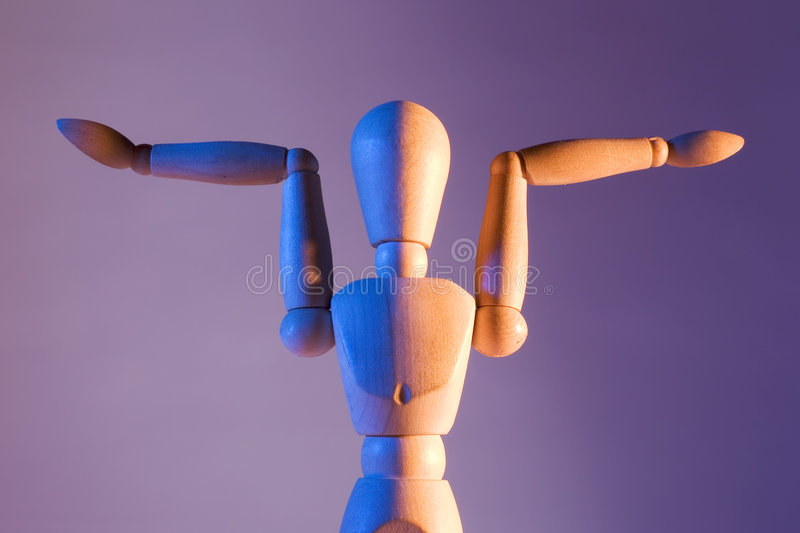 Artist mannequin. An artist's mannequin posed in funny positions royalty free stock image