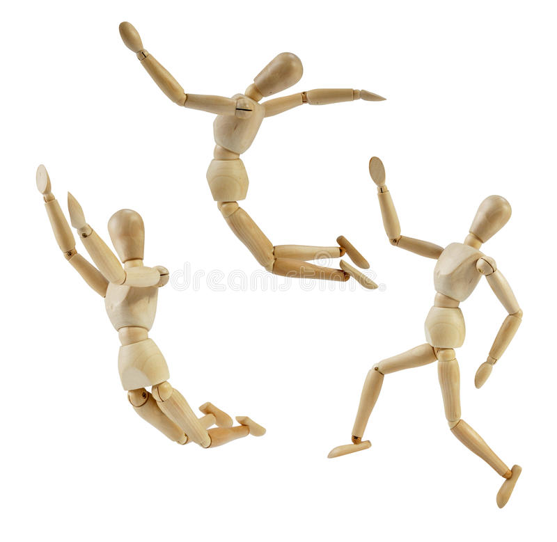 Artist Mannequin in jump poses. Isolated wood human model royalty free stock photography