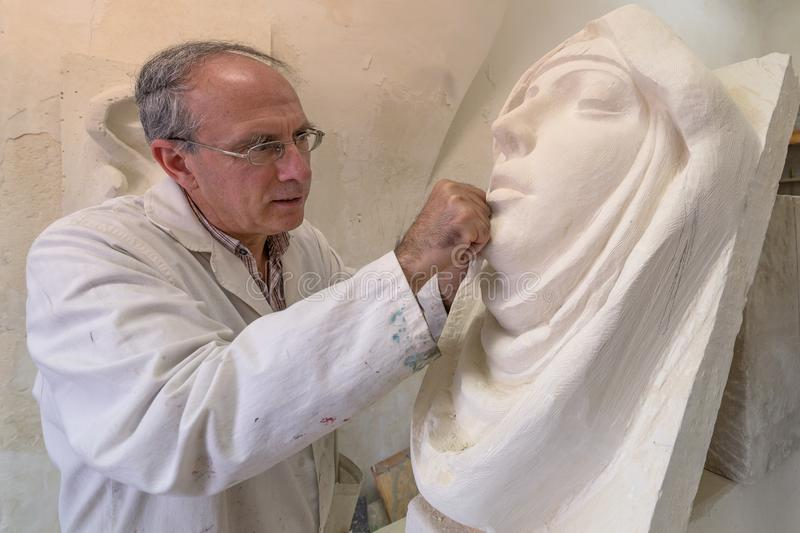 Artist master at work in studio on a sculpture of face vector illustration