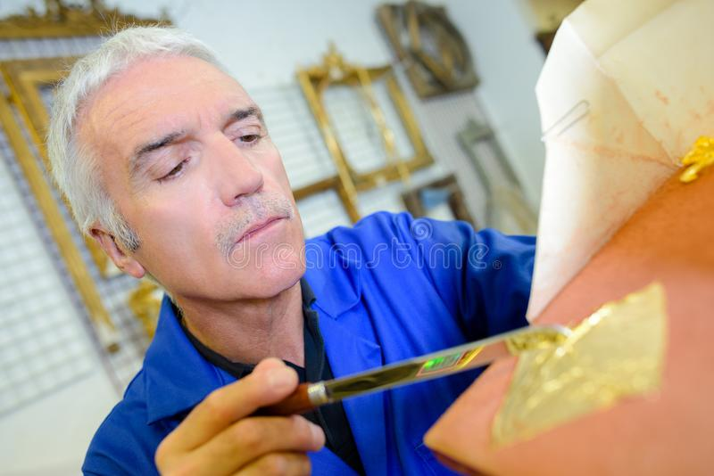 Artist mixing some color. Art stock photo