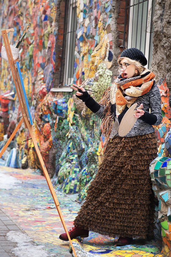 Artist, painter woman at work. Delight, surprise, admiration stock image