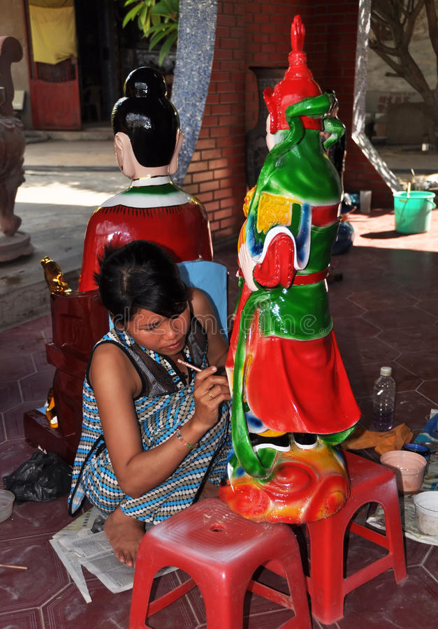 Artist Painting Statue at Floating Temple, Vietnam