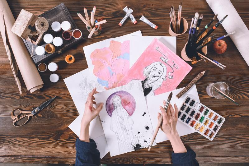 Artist painting with watercolor paints royalty free stock images