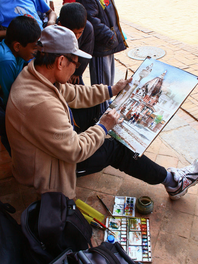 An artist painting watercolor in Patan Durbar Square in Nepal. An artist painting watercolor in Patan Durbar Square in Kathmandu, Nepal royalty free stock photo