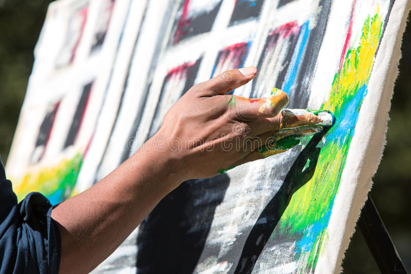 Artist Paints Canvas With His Fingers At Atlanta Arts Festival. Atlanta, GA, USA - October 17, 2015: An artist paints with his fingers in the Elevate Art royalty free stock photography