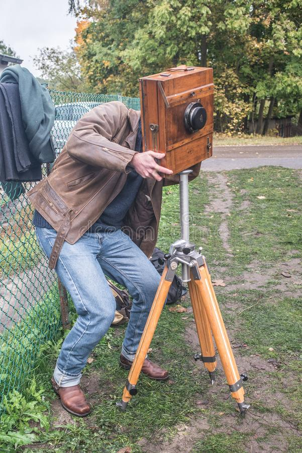 Artist photographer with wet plate camera on tripod stock image