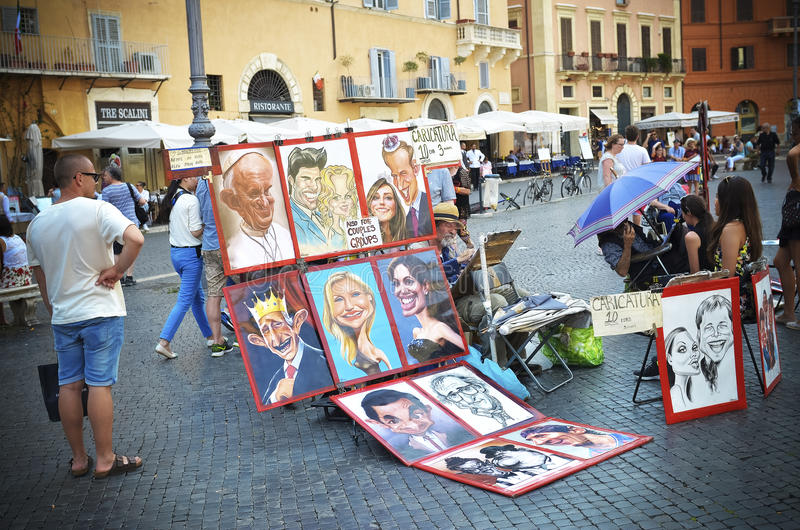 Artist in Piazza Navona Rome, Italy. Rome, Italy - June 30, 2016: caricatures of celebrities for sale are displayed in Piazza Navona caricaturist paint stock image