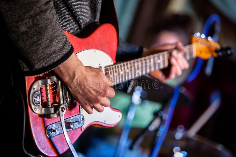 Artist playing electric guitar on the stage royalty free stock photo