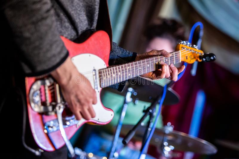 Artist playing electric guitar on the stage stock photos