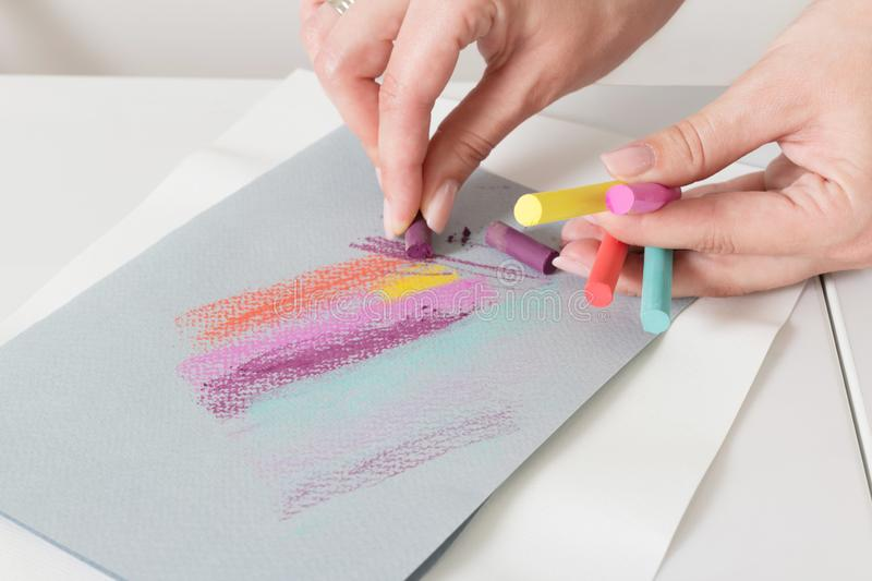 Artist`s hand draw chalk pastels on paper abstract lines royalty free stock images