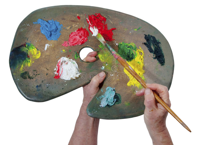 Artist's hands and colour palette stock image