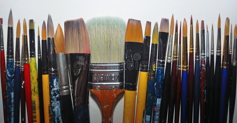 Artist`s paint brushes stock photos