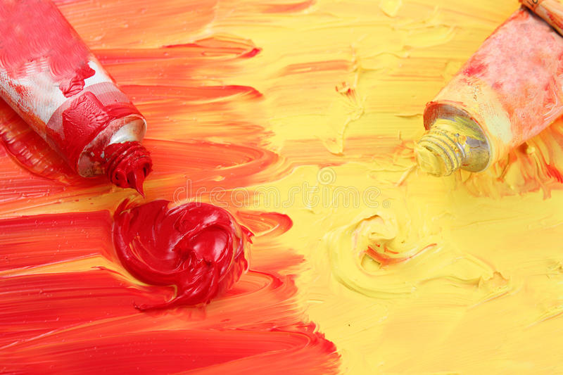 Artist's red and yellow paint stock photography