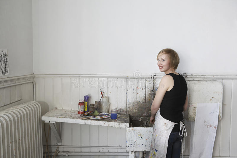 Superb Download Artist Standing By Dirty Sink In Studio Stock Image   Image:  33887997