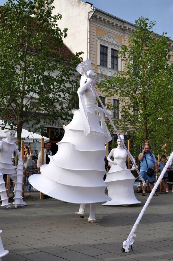 Artist on stilts, street theater stock photo