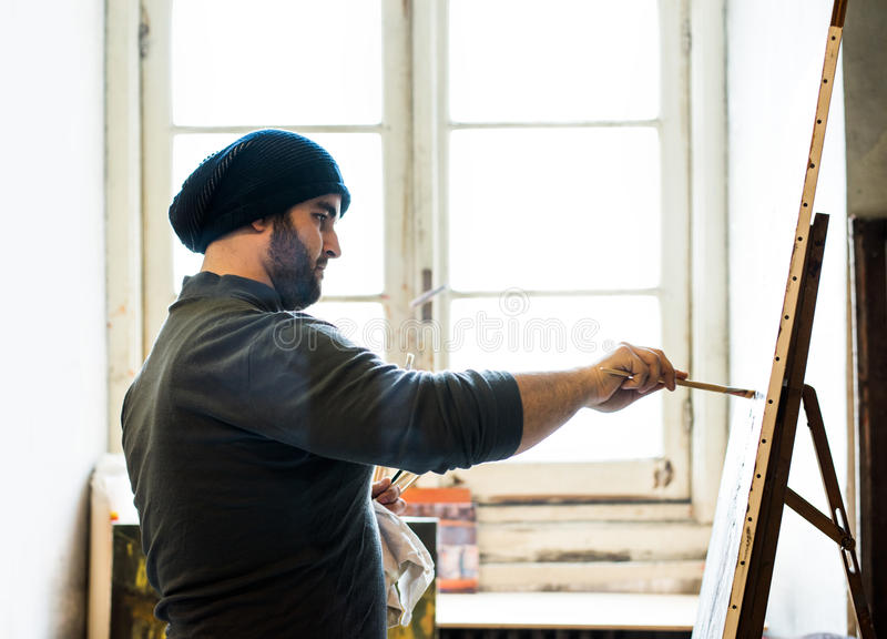 Artist/teacher demonstrating a technique on a canvas - silhouette stock photos