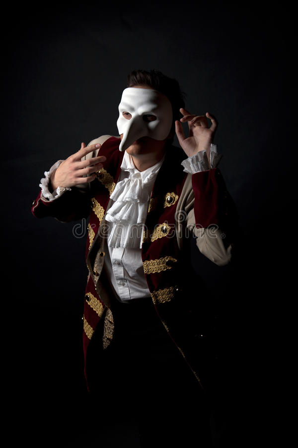 Artist in a venetian mask. Theater artist in a venetian mask carnival royalty free stock photography