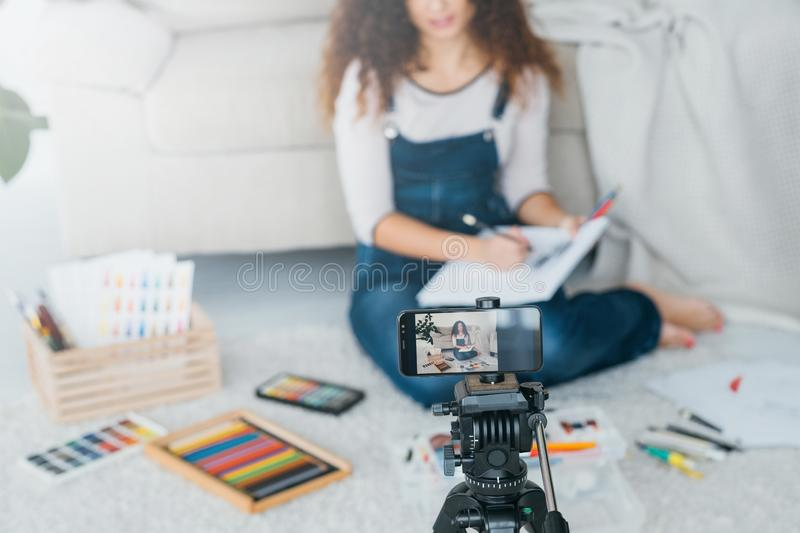 Artist vlog lady drawing recording tutorial video stock photo