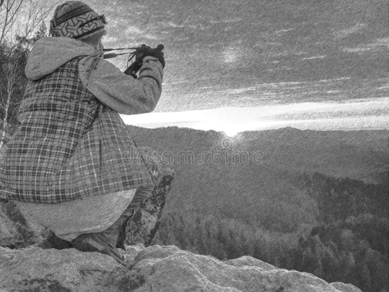 Artist woman with mirror camera on peak of rock. Dreamy  lland stock images
