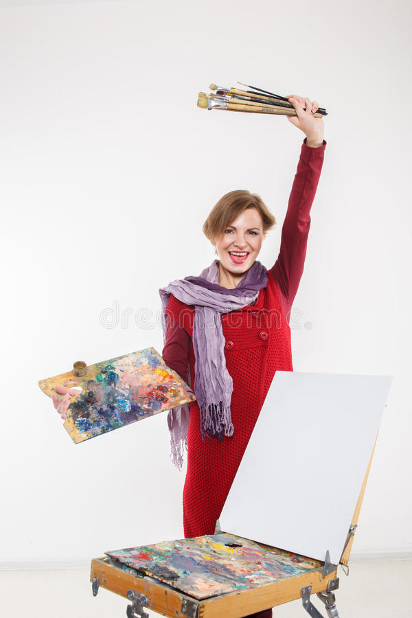 Artist woman at work. . Artist woman at work. on a white background royalty free stock photography