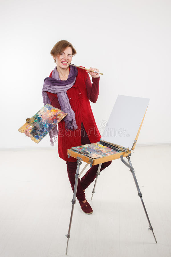Artist woman at work. . Artist woman at work. on a white background stock photography