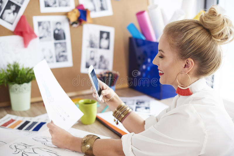 Artist woman working at the workshop. Express yourself with creativty and designing stock photo