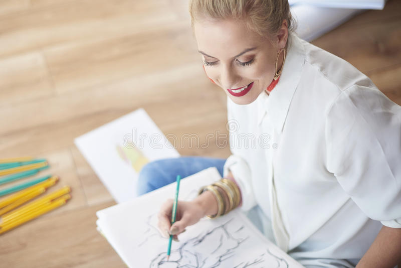 Artist woman working at the workshop. Fresh projects they are coming up royalty free stock images