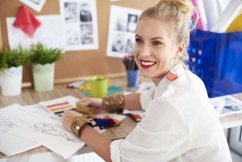 Artist woman working at the workshop. Motivated fashion designer to succeed royalty free stock photo