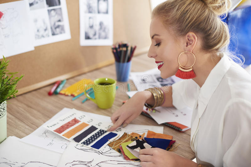 Artist woman working at the workshop. This seems like the right choice royalty free stock image