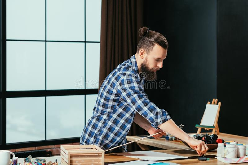 Artist workplace bearded painter tools inspiration royalty free stock image