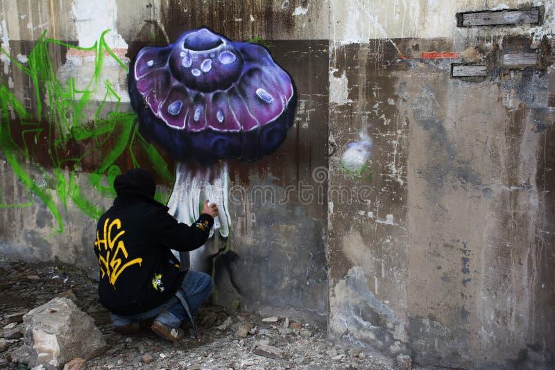 Artista con la poder de espray que pinta stock de ilustración