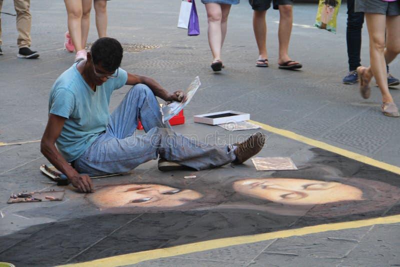 Artista de la calle en la calle en Florencia fotografía de archivo