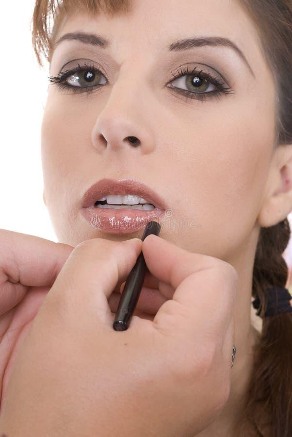 Artista de maquillaje y el modelo imagen de archivo