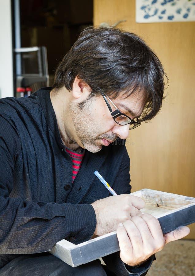Tela di firma dell'olio dell'artista del pittore immagine stock libera da diritti