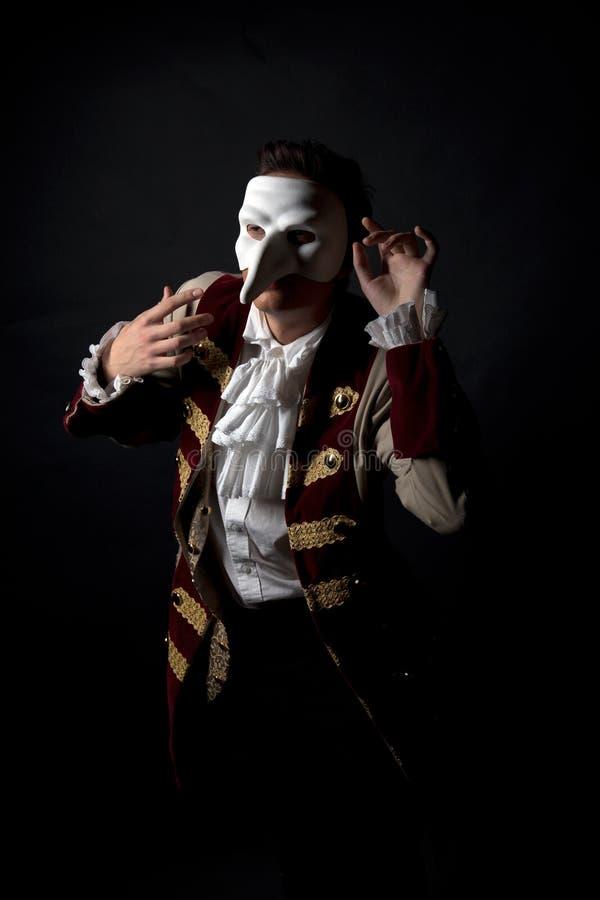Artista en una máscara veneciana fotografía de archivo libre de regalías