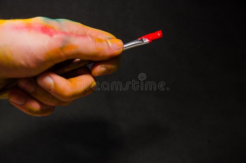 Artista Holding Paintbrush fotos de archivo libres de regalías