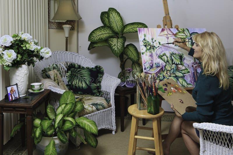Artista nella sua verniciatura di anni '50 immagini stock libere da diritti