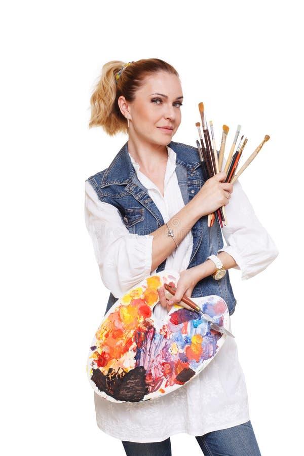 Artiste de femme avec les brosses et la palette, d'isolement photo stock
