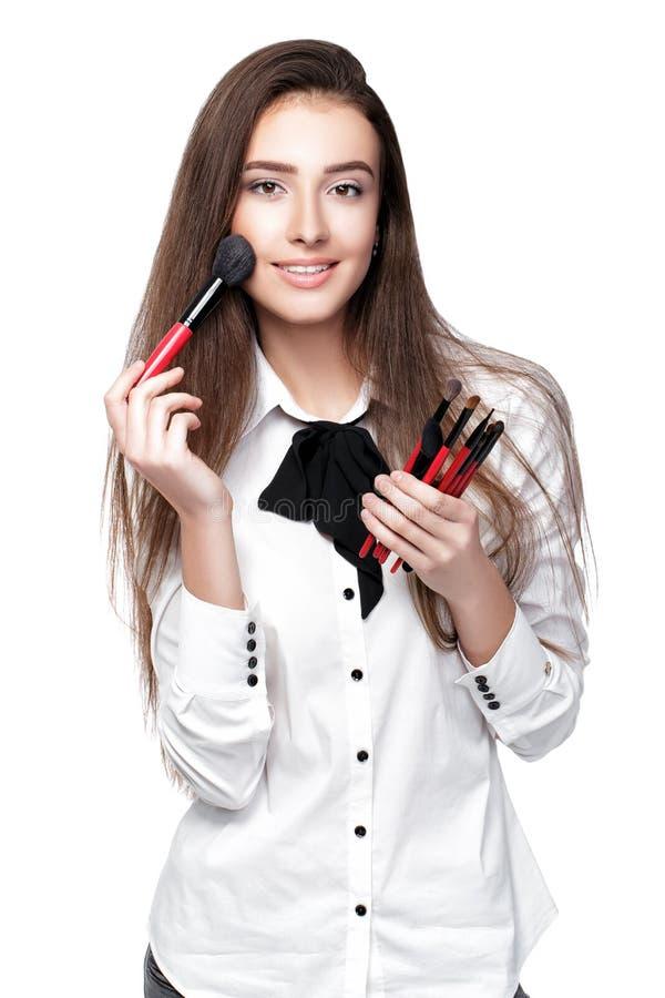Artiste de maquillage tenant la brosse de maquillage photos stock