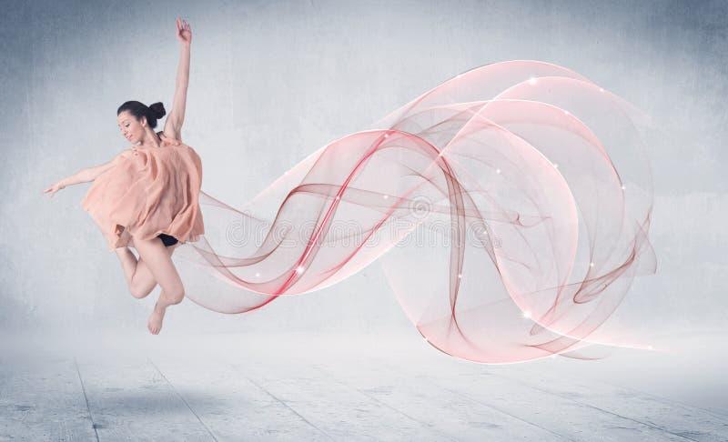 Artiste de représentation de ballet de danse avec le remous abstrait photos stock